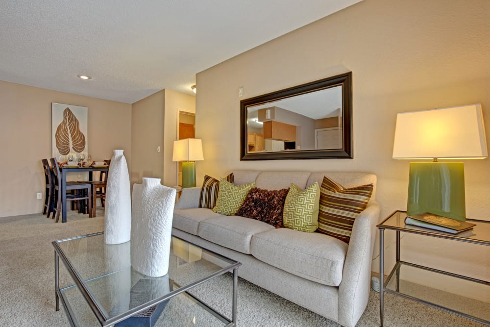 Model living room with glass coffee table at The Lakes of Schaumburg in Schaumburg, Illinois
