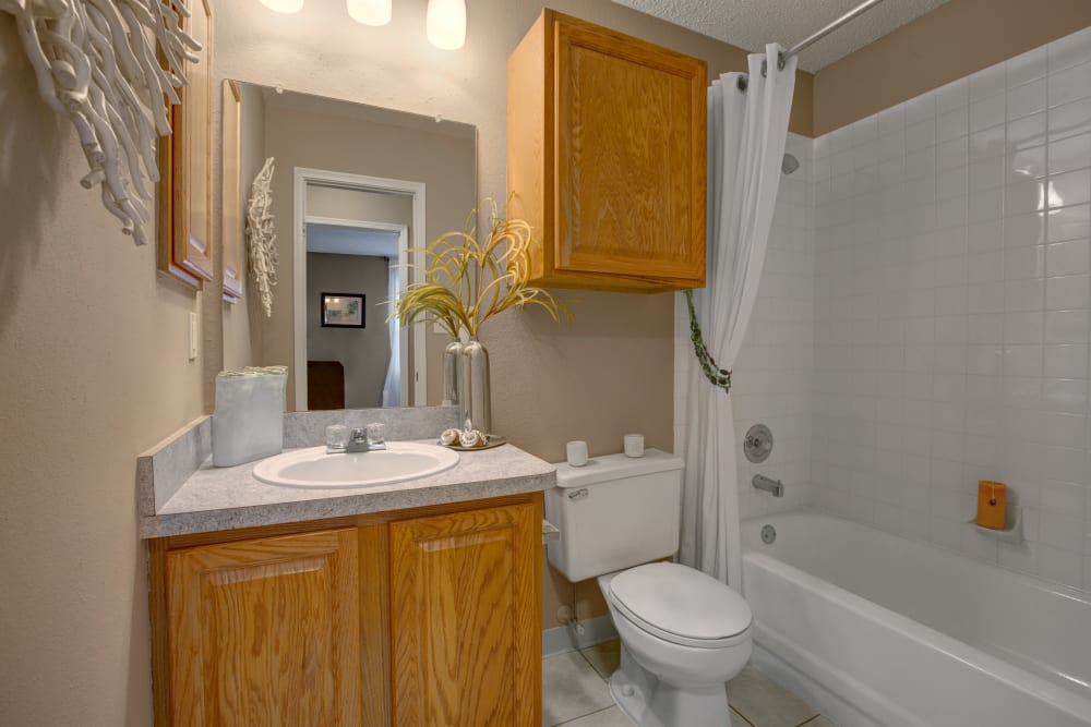 Model bathroom with plenty of storage cabinets and an oval tub at The Lakes of Schaumburg in Schaumburg, Illinois