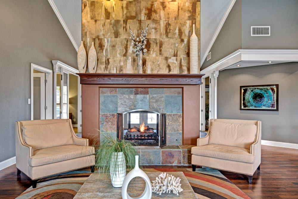 Accent chairs near the fireplace in the clubhouse at The Lakes of Schaumburg in Schaumburg, Illinois