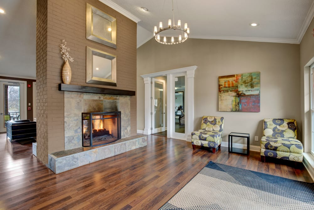 Clubhouse fireplace with hardwood floors and modern Decor at The Lakes of Schaumburg in Schaumburg, Illinois