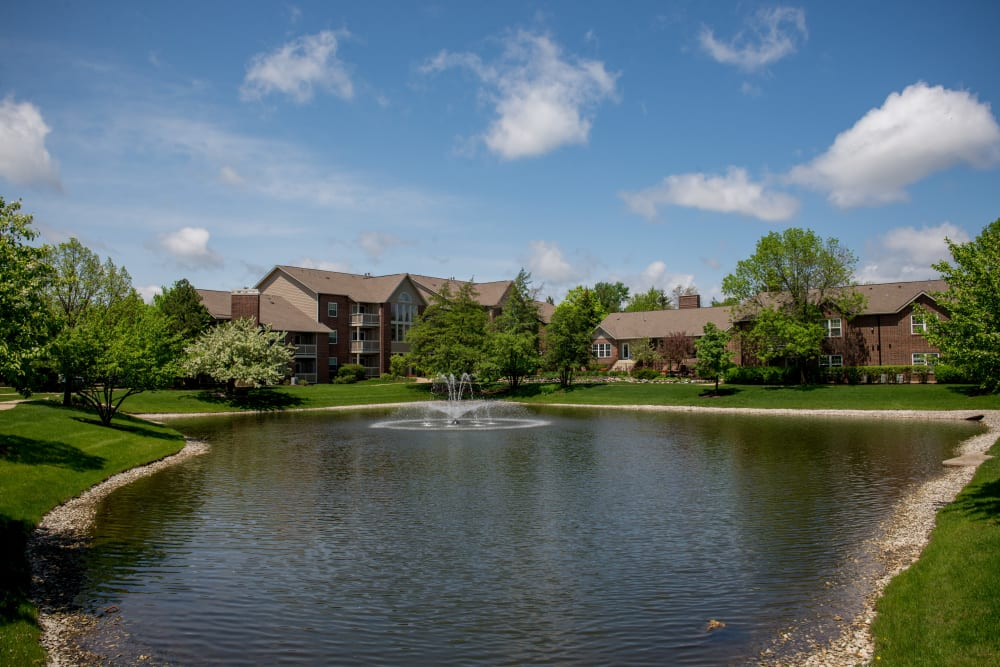 View of the pond and fountain outside of The Lakes of Schaumburg in Schaumburg, Illinois