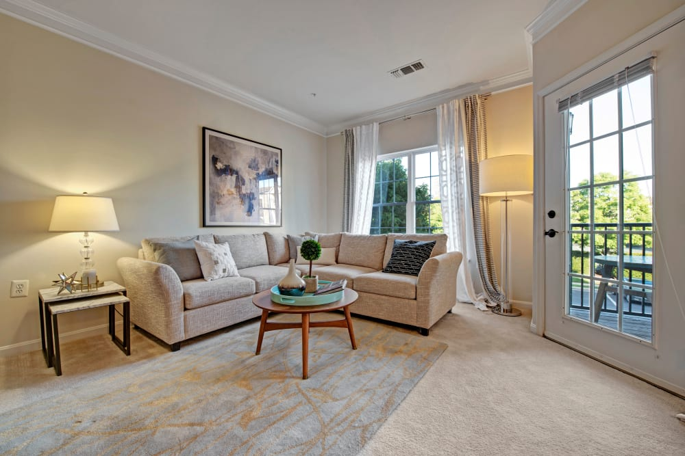 Living room with door to outside at Dulles Greene in Herndon, Virginia