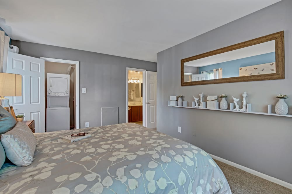 Well decorated model bedroom with closet view at The Gateway in Gaithersburg, Maryland