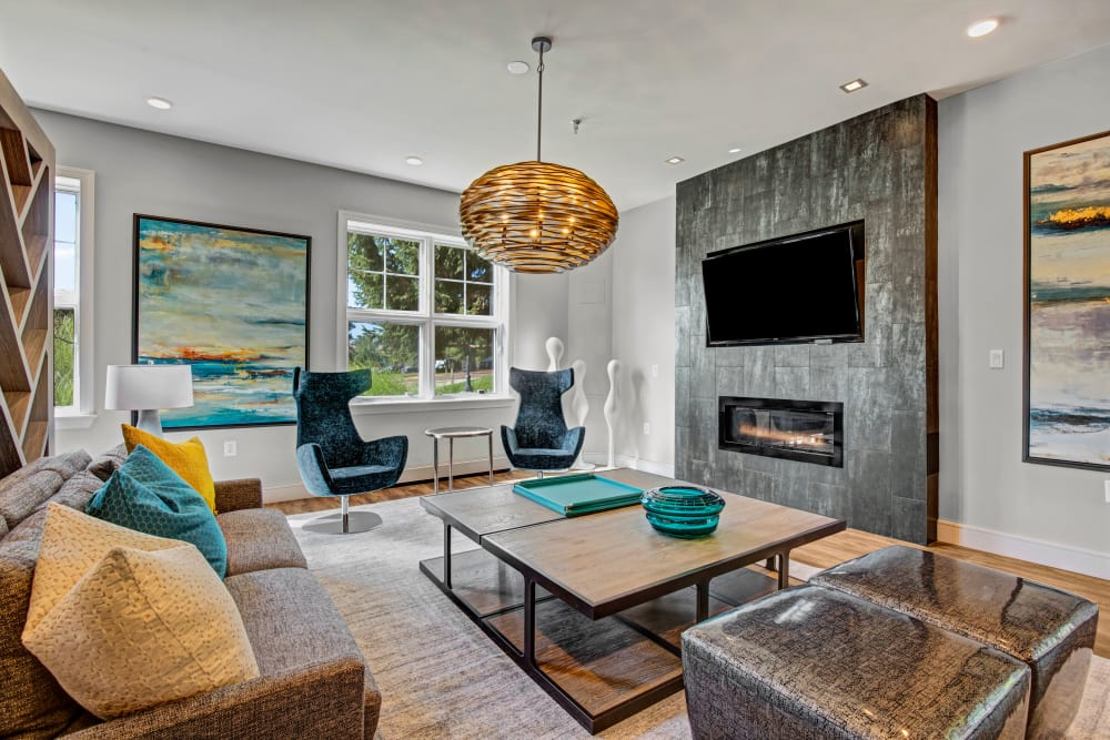 Well decorated model living room with blue accent chairs at The Gateway in Gaithersburg, Maryland