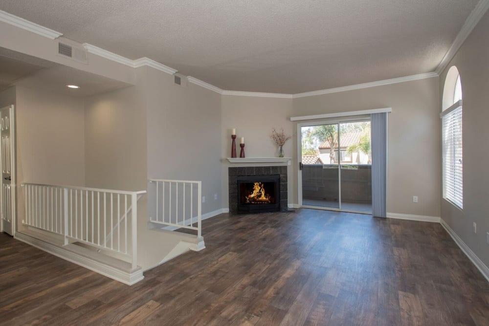 Large living room with wood-style flooring at Niguel Summit Condominium Rentals in Laguna Niguel, California