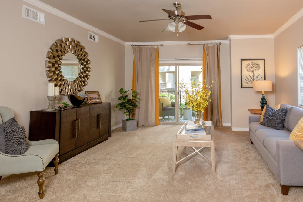 A living room with patio access at Wolf Ranch Condominium Rentals in Sacramento, California