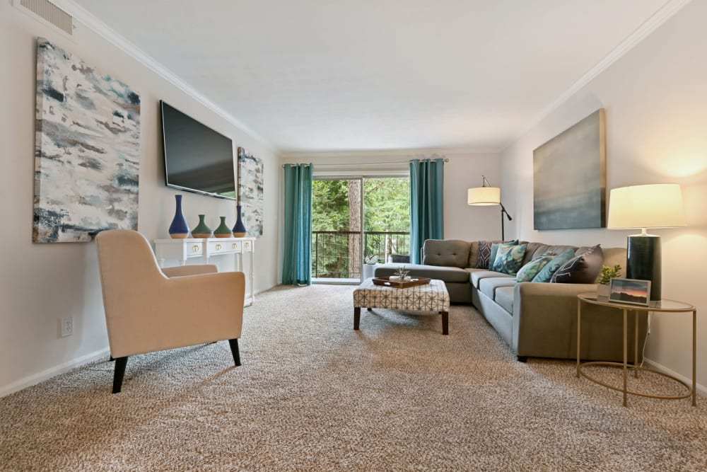 Modern decor and plush carpeting in a model home's living area at Crest at Riverside in Roswell, Georgia