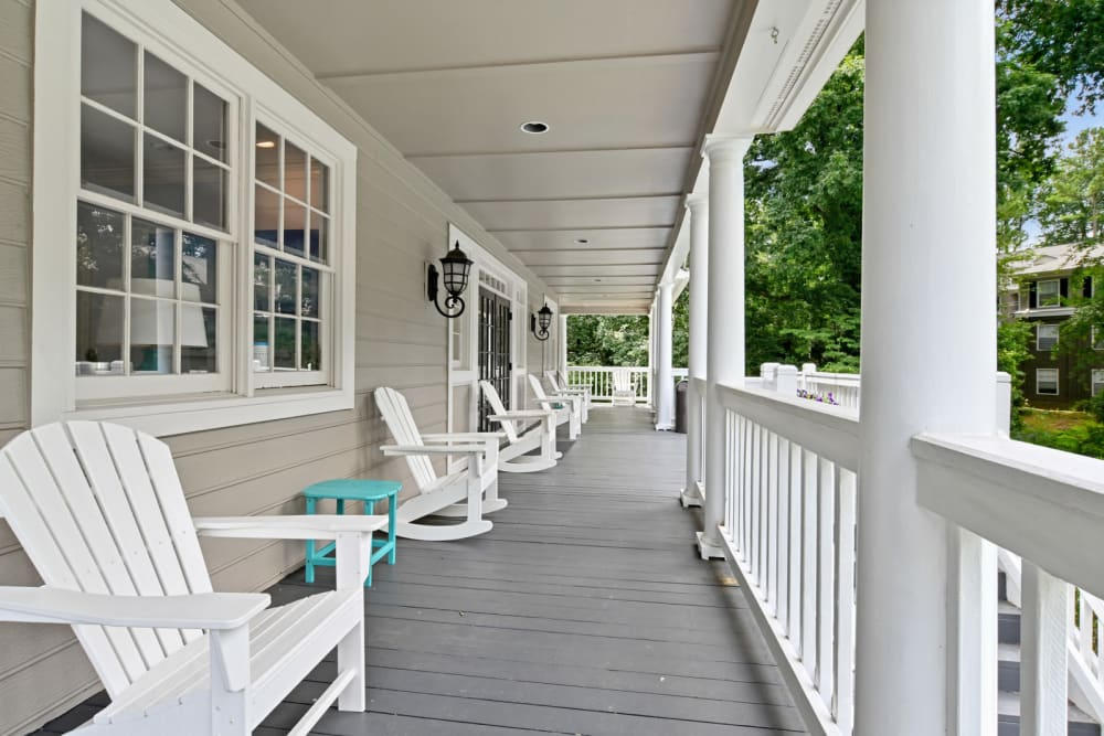 Large veranda outside the clubhouse with comfortable seating at Crest at Riverside in Roswell, Georgia
