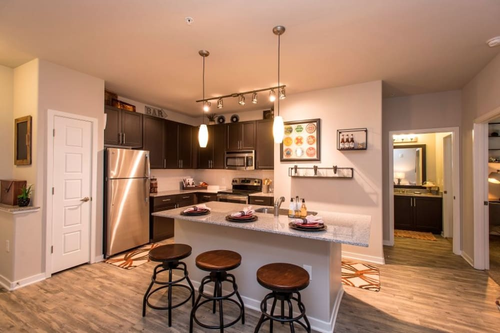 Breakfast bar seating in stylish kitchen at Luxe Scottsdale Apartments in Scottsdale, Arizona