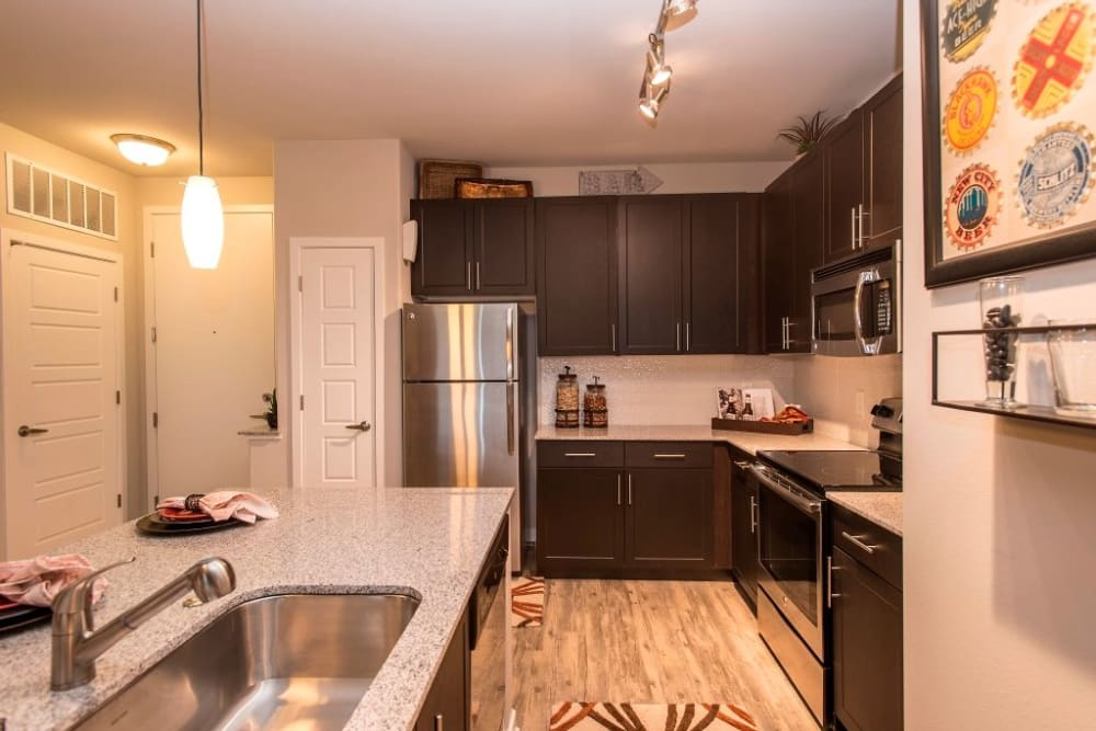 Kitchen with ample countertop space at Luxe Scottsdale Apartments in Scottsdale, Arizona
