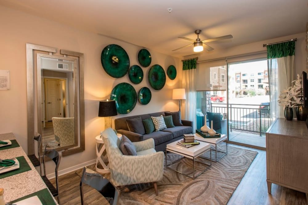 Living room with unique art on the walls at Luxe Scottsdale Apartments in Scottsdale, Arizona