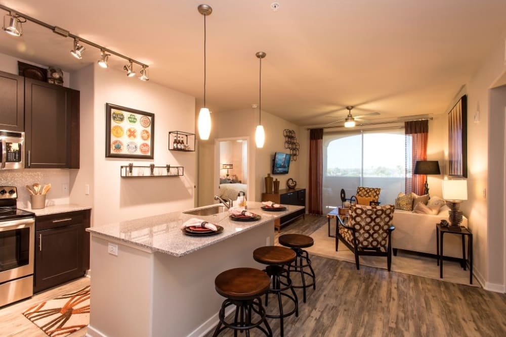 Modern kitchen featuring island countertop seating at Luxe Scottsdale Apartments in Scottsdale, Arizona