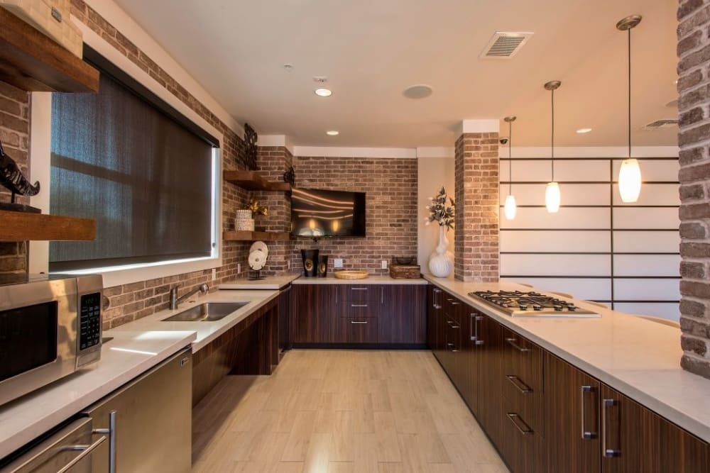 Community kitchen space at Luxe Scottsdale Apartments in Scottsdale, Arizona