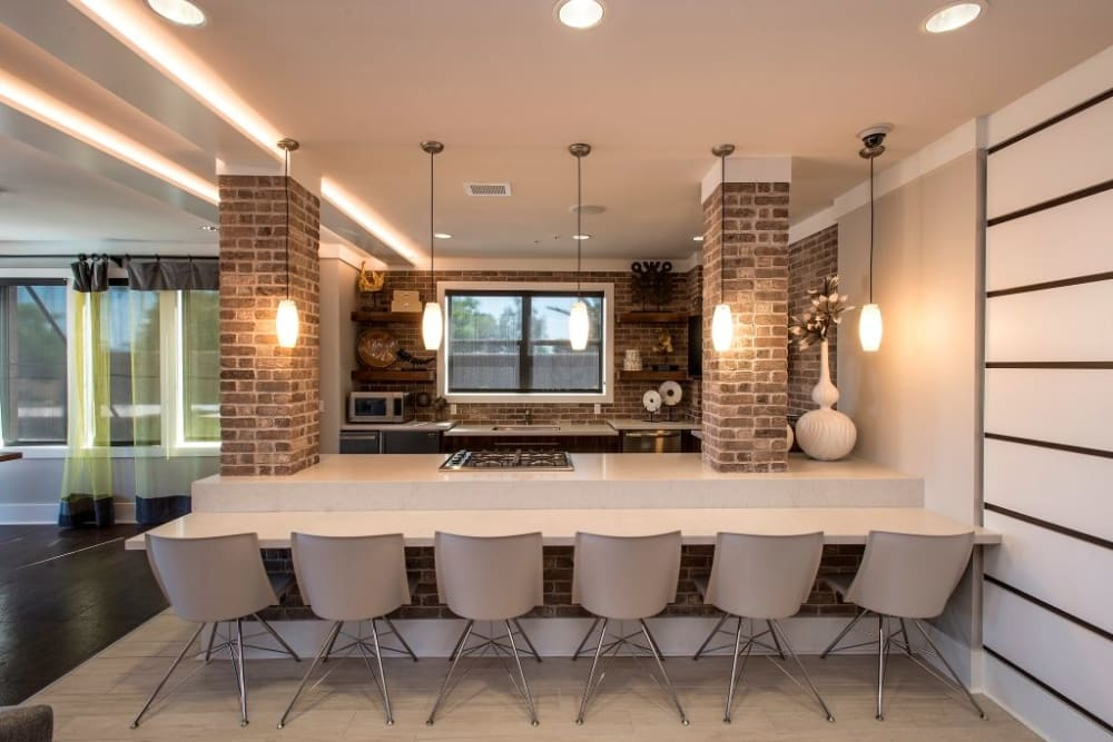 Large dining table inside clubhouse at Luxe Scottsdale Apartments in Scottsdale, Arizona