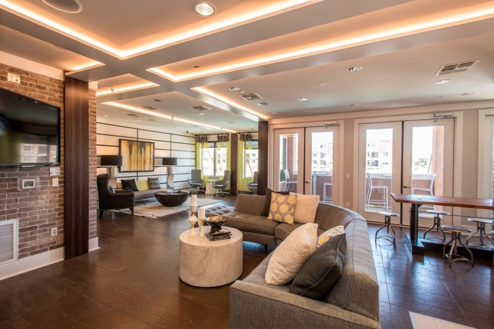 Stylish clubhouse with sitting areas and tall ceilings at Luxe Scottsdale Apartments in Scottsdale, Arizona
