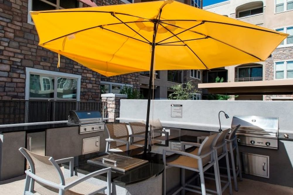 Outdoor barbecue and sitting area at Luxe Scottsdale Apartments in Scottsdale, Arizona