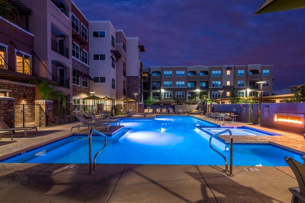 Luxurious outdoor community pool up at night at Luxe Scottsdale Apartments in Scottsdale, Arizona