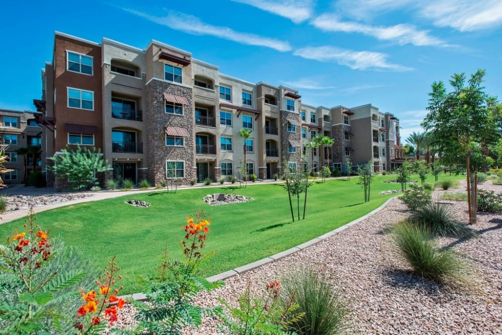 Well manicured landscaping outside a perfect building at Luxe Scottsdale Apartments in Scottsdale, Arizona