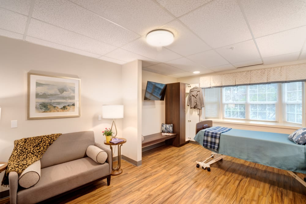 A resident suite with large windows at Mission Healthcare at Bellevue in Bellevue, Washington.