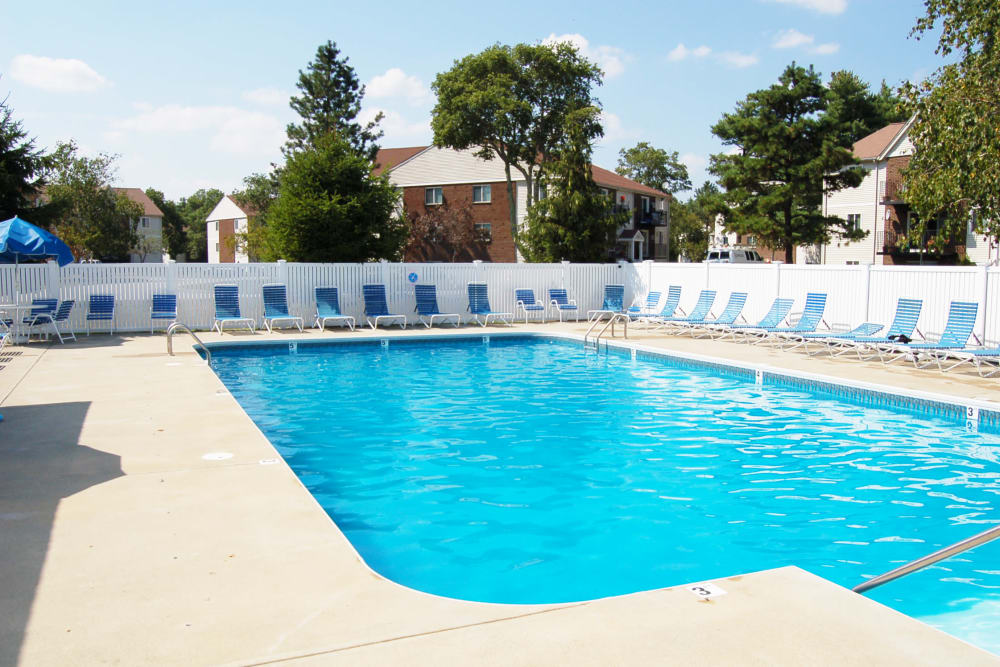 Outdoor swimming pool on a sunny day at The Village at Marshfield in Marshfield, Massachusetts