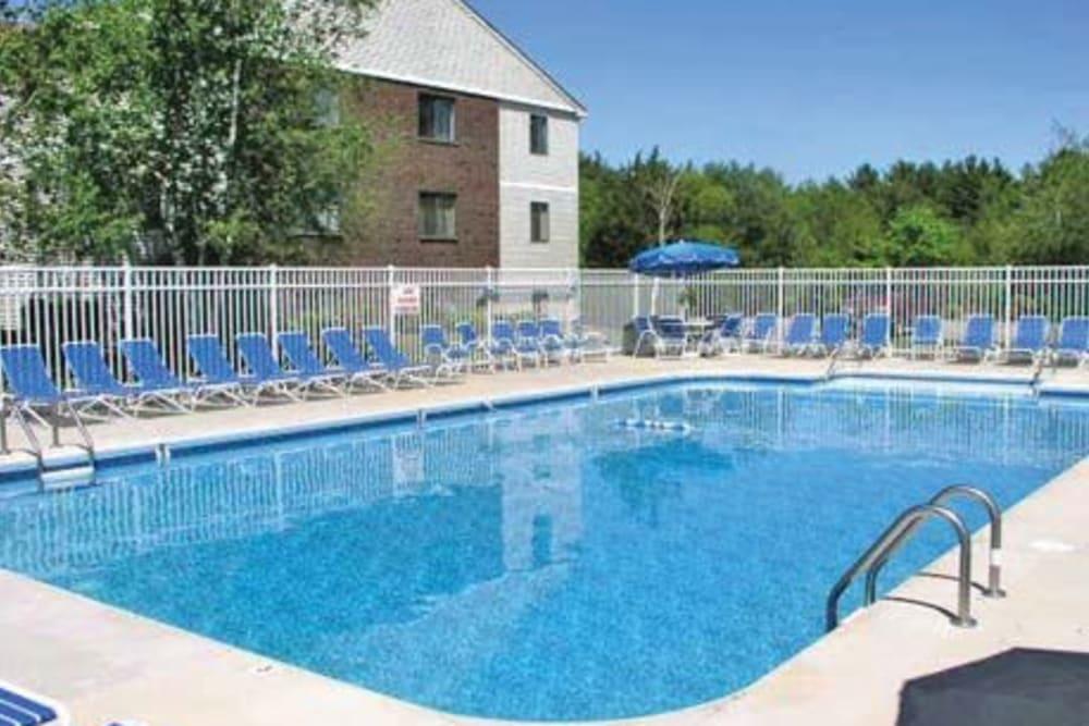 Plenty of seating poolside at The Village at Marshfield in Marshfield, Massachusetts
