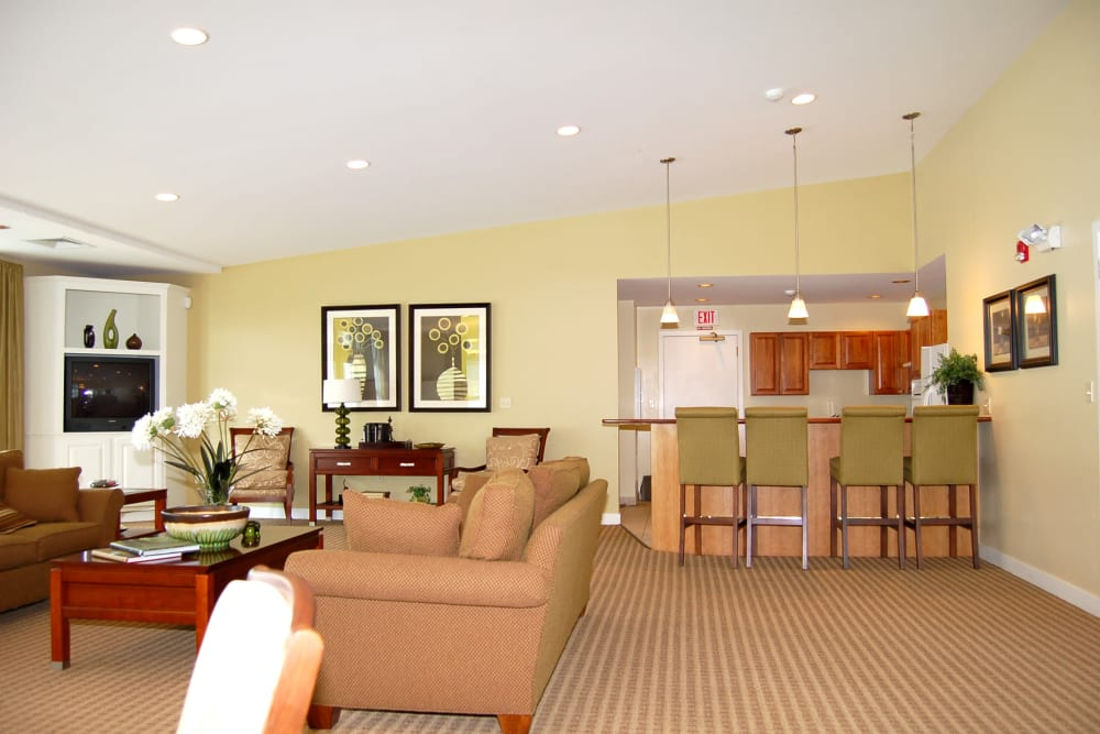 Clubhouse interior with plenty of seating at The Village at Marshfield in Marshfield, Massachusetts