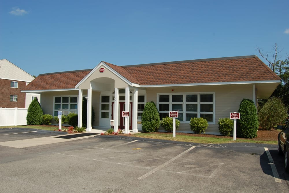 Leasing office exterior with parking at The Village at Marshfield in Marshfield, Massachusetts