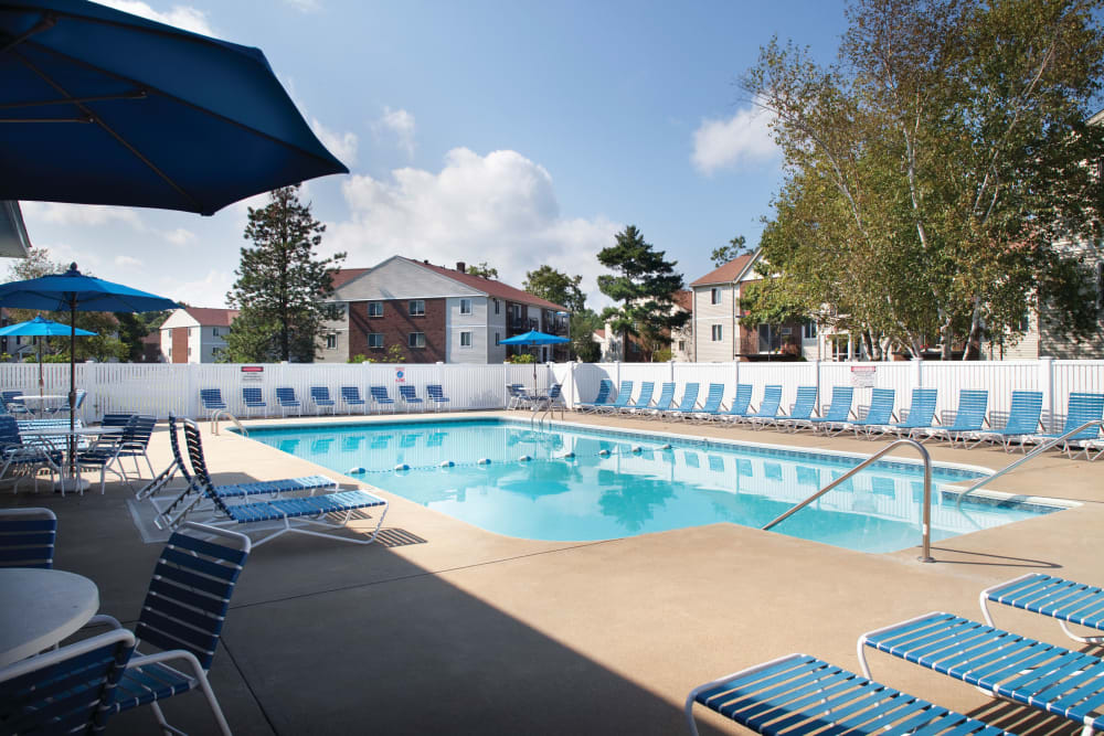 Shaded tables and chairs available poolside at The Village at Marshfield in Marshfield, Massachusetts