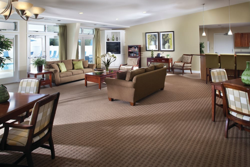 Couches, tables, and TVs in the clubhouse at The Village at Marshfield in Marshfield, Massachusetts