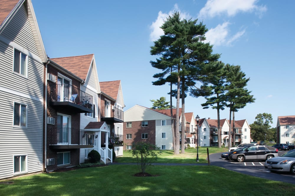 Well manicured landscape outside of units at The Village at Marshfield in Marshfield, Massachusetts