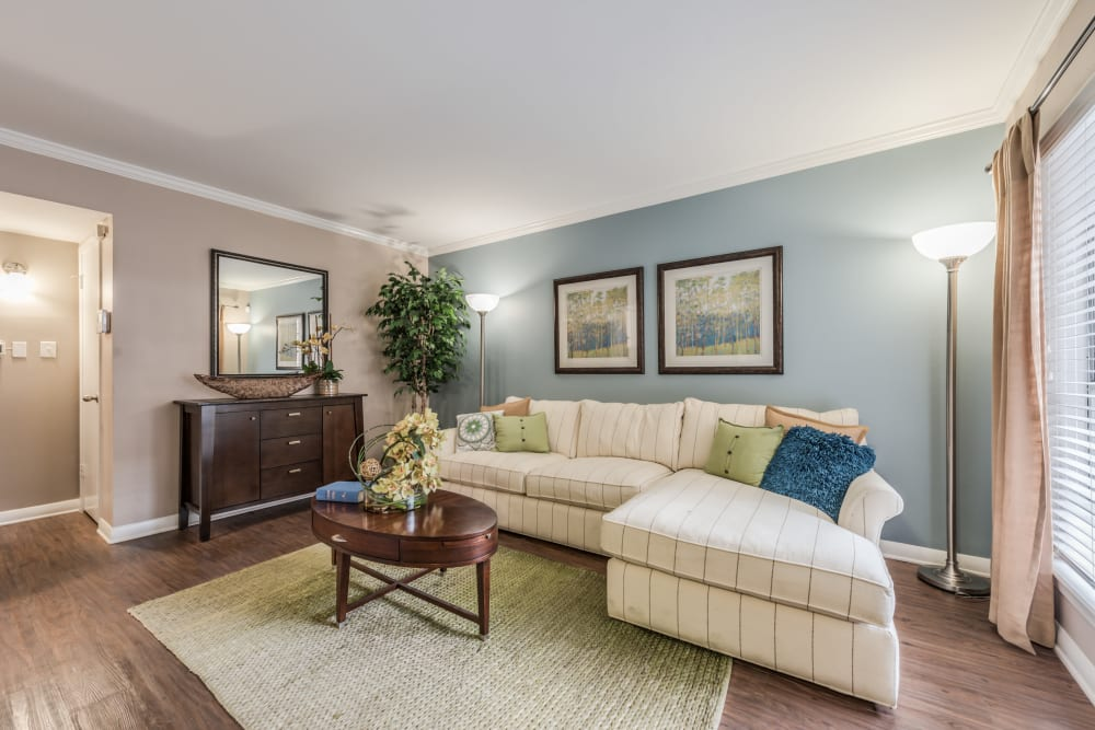 Brightly lit model living room with modern decor at The Villages at Meyerland in Houston, Texas