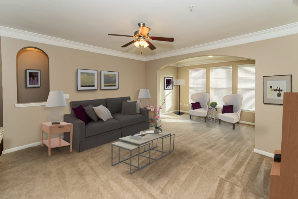 Living room with modern decor and ceiling fan at Vista 121 Apartment Homes in Lewisville, Texas