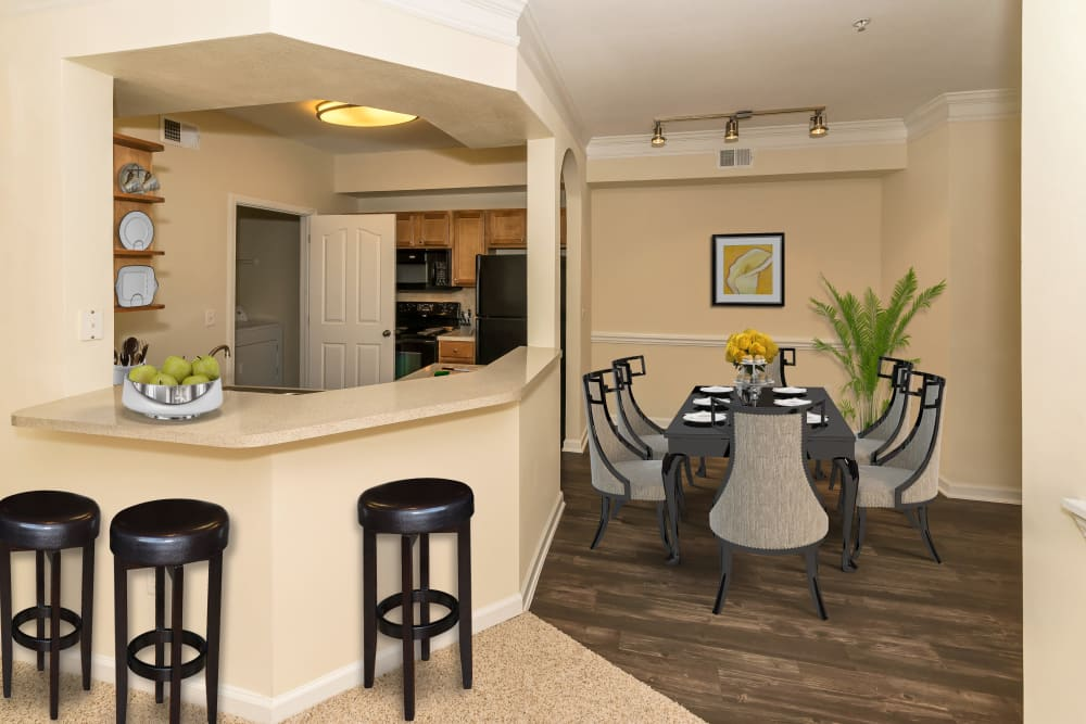 View of the kitchen bar and dining nook at Vista 121 Apartment Homes in Lewisville, Texas