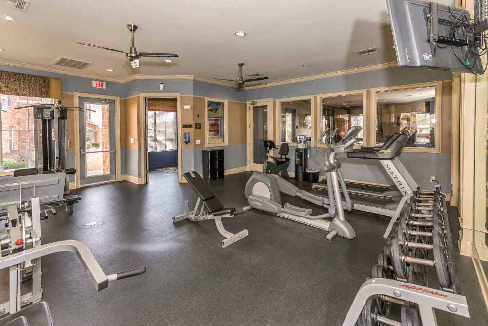 Free weights in the fitness center at Vista 121 Apartment Homes in Lewisville, Texas