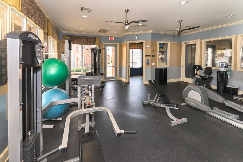 Plenty of weight machines in the fitness center at Vista 121 Apartment Homes in Lewisville, Texas