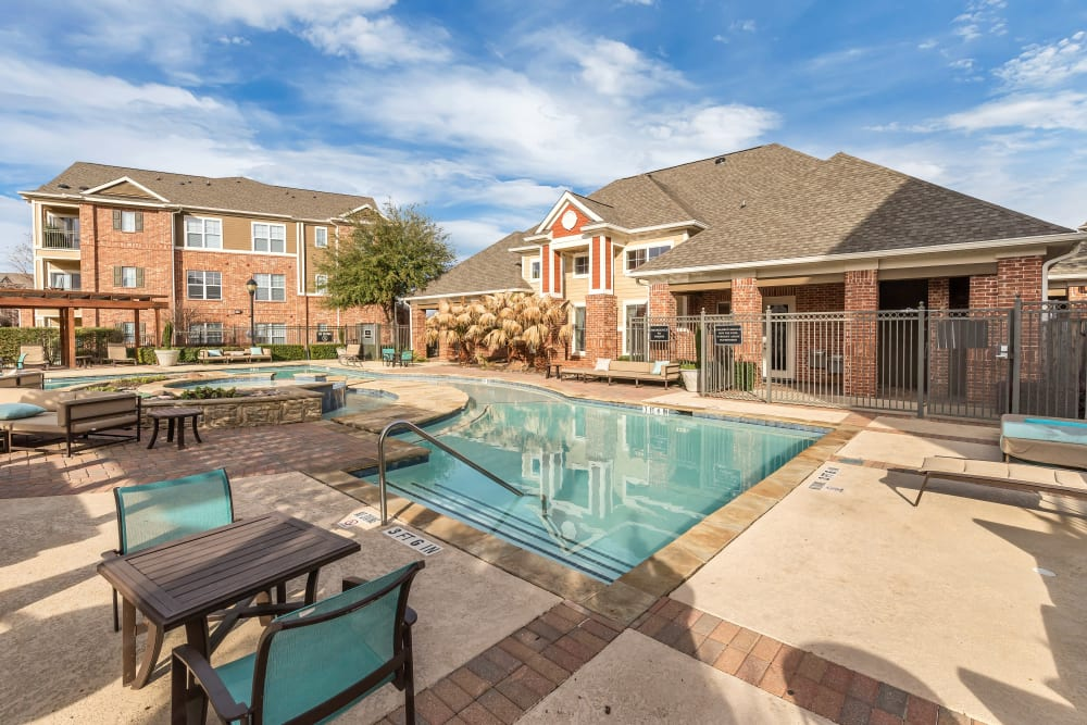 Plenty of poolside seating at Vista 121 Apartment Homes in Lewisville, Texas