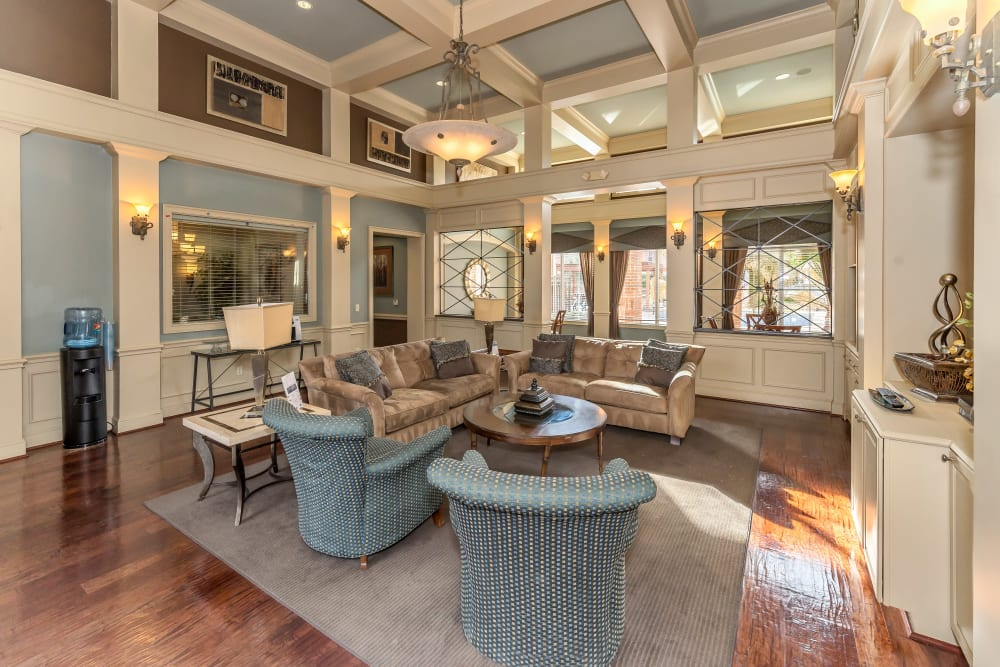 Clubhouse interior with modern decor at Vista 121 Apartment Homes in Lewisville, Texas