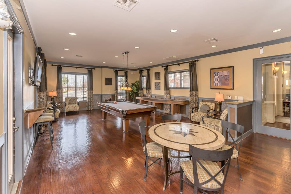 Game tables in the clubhouse at Vista 121 Apartment Homes in Lewisville, Texas