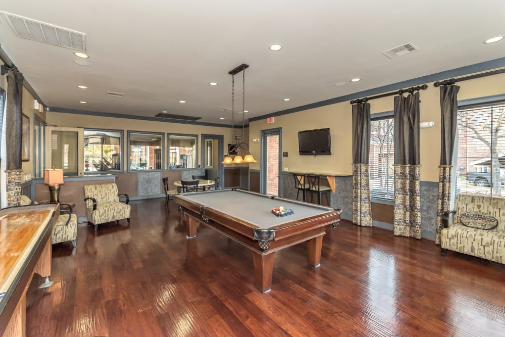 Pool table and shuffleboard in the Clubhouse at Vista 121 Apartment Homes in Lewisville, Texas