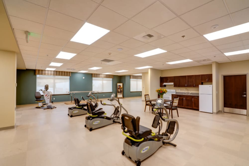 Wellness room with exercise machines at Mission Healthcare at Renton in Renton, Washington.