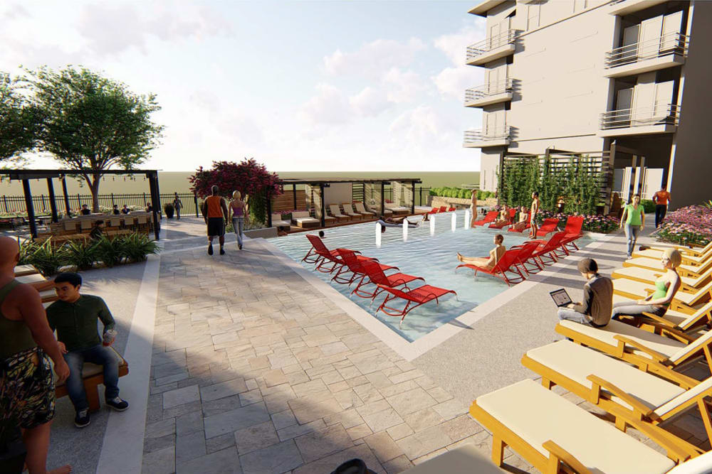 Rendering of the luxurious swimming pool area with plenty of chaise lounge chairs at Magnolia on the Green in Allen, Texas