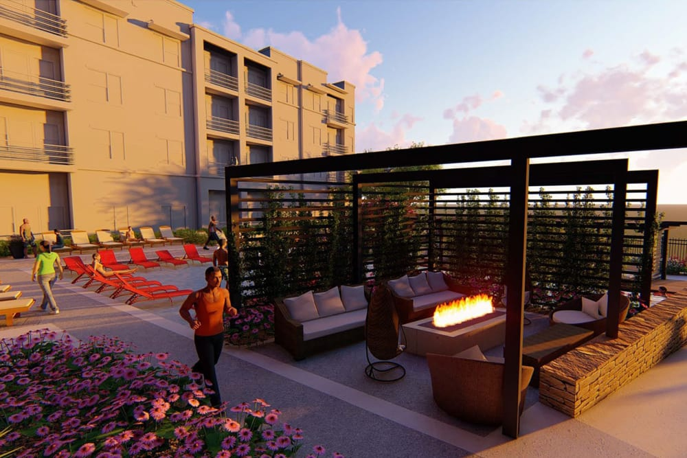 Rendering of a resident walking by the fire pit area just before sunset at Magnolia on the Green in Allen, Texas