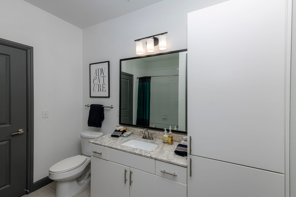 Ample storage space in a contemporary model home's bathroom at Twin Creeks Crossing in Allen, Texas