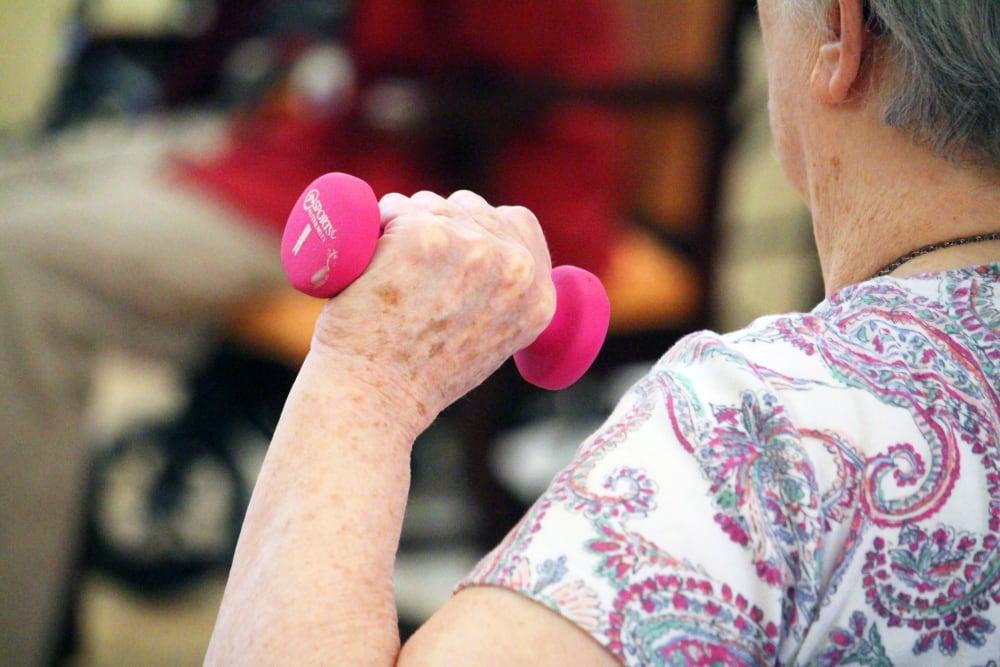 Woman exercising at Pennington Gardens