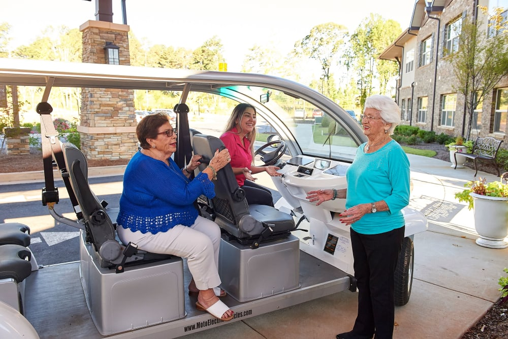 Transportation shuttle picking up and dropping residents off at Celebration Village Forsyth in Suwanee, Georgia