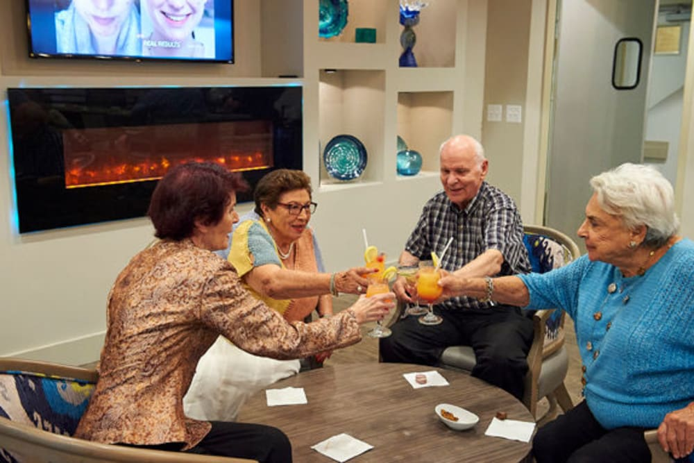 Residents gathered in the onsite lounge for cocktails at Celebration Village Forsyth in Suwanee, Georgia