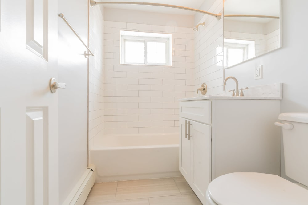 Bright, clean bathroom at Eagle Rock Apartments at Carle Place in Carle Place, New York