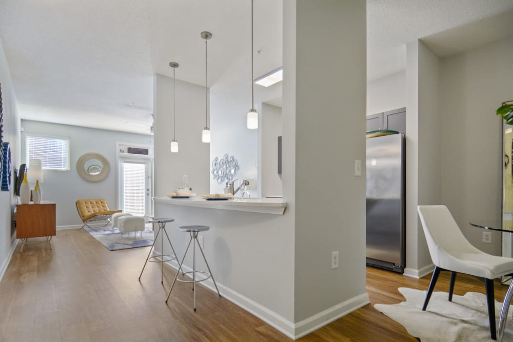 Beautiful open-concept floor plan with high ceilings and hardwood floors in a model home at Ellington Midtown in Atlanta, Georgia