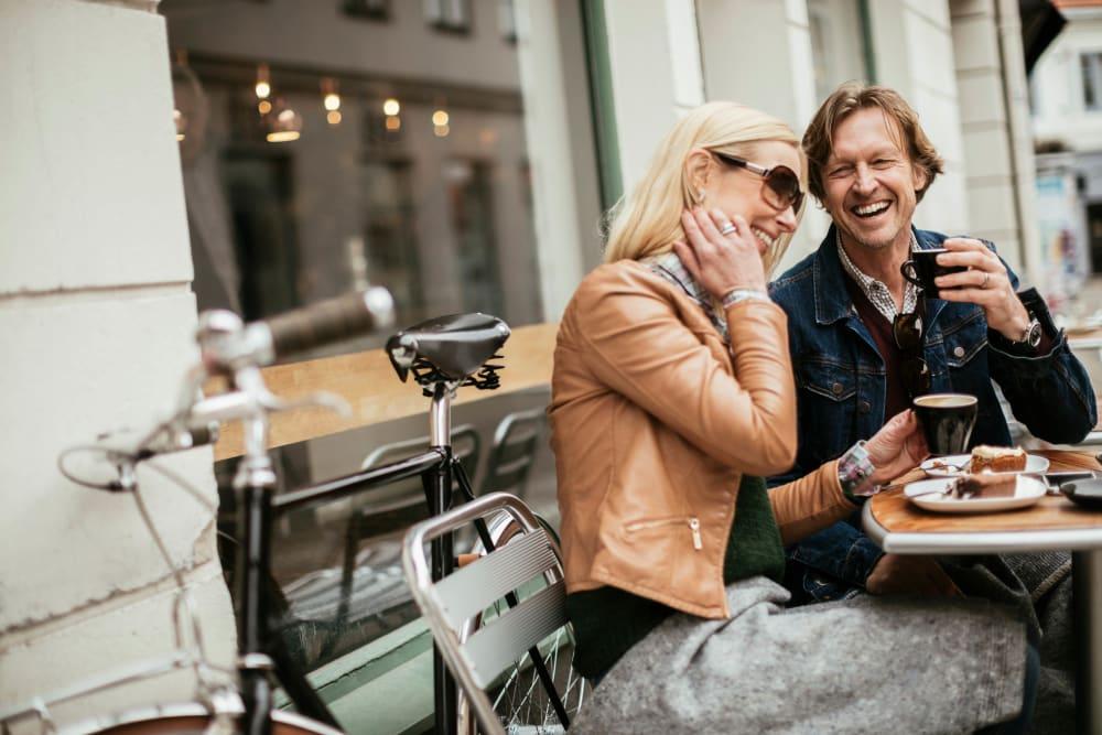 Couple enjoying morning coffee and conversation at their favorite café near Ellington Midtown in Atlanta, Georgia