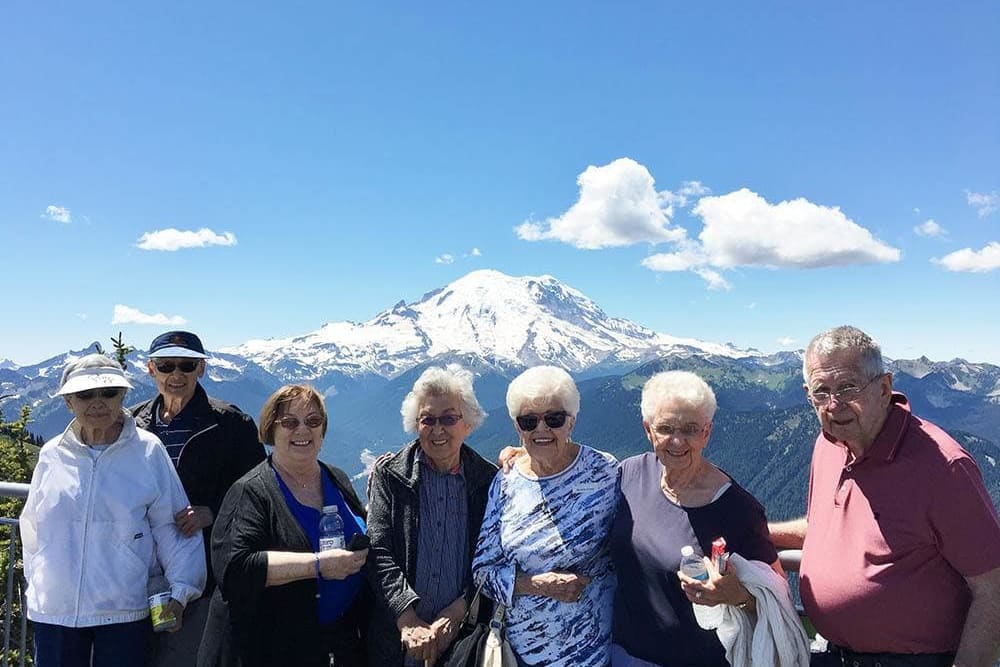 A group of residents viewing a mountain near Merrill Gardens at Tacoma in Tacoma, Washington.
